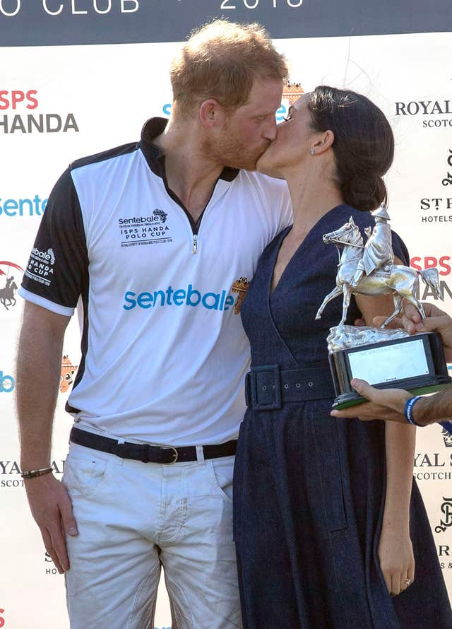 Harry and Meghan kiss at the polo