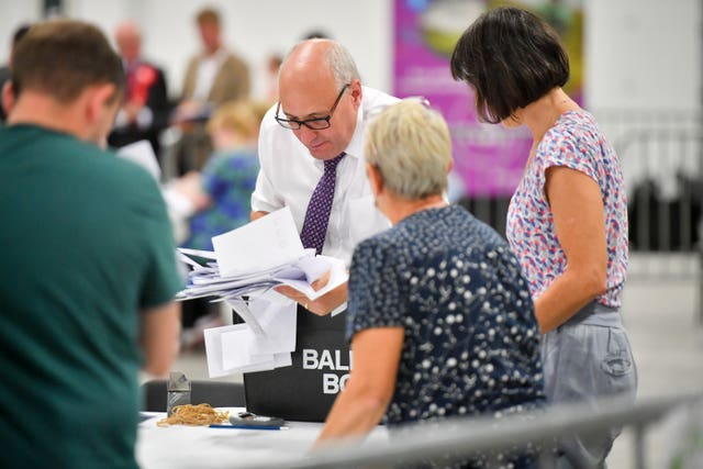 Votes are taken from a ballot box during the count of votes in the Brecon and Radnorshire by-election in August 2019 (Ben Birchall/PA)