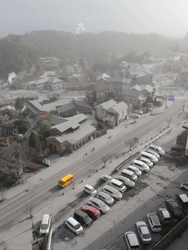 Cars and buildings covered with volcanic ash (Takuto Kaneko/Kyodo News/AP)