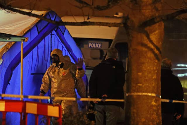 Investigators next to a police tent outside the Mill pub at the Maltings in Salisbury (Steve Parsons/PA)