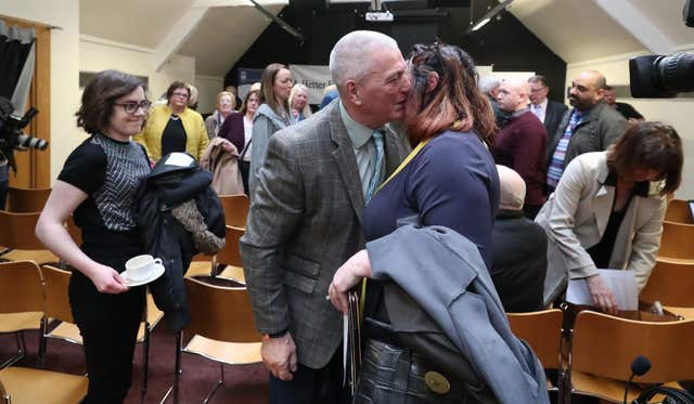 Jackie McDonald of Ulster Defence Association is hugged by a well wisher at a press conference at Linenhall Library, Belfast (Niall Carson/PA)