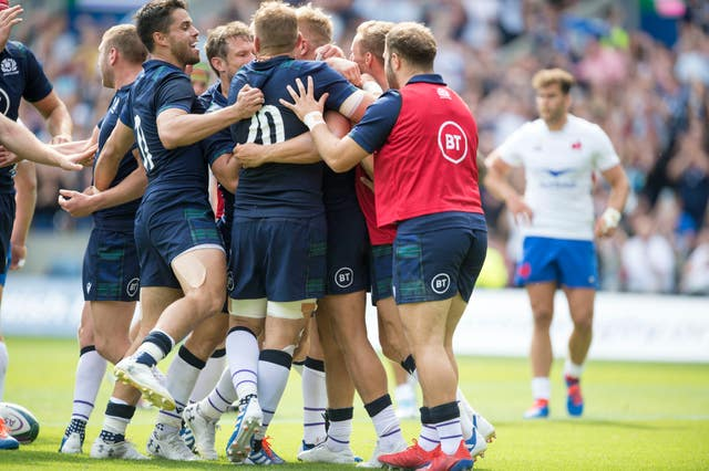 Scotland players celebrate with Chris Harris after he scored Scotland's second try