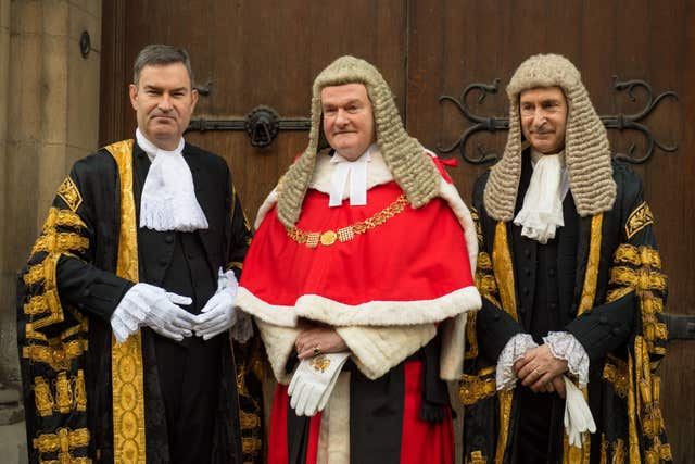 Lord Chancellor David Gauke (left) poses for a photo with Lord Chief Justice Lord Thomas of Cwmgiedd (centre) and Master of the Rolls Sir Terence Etherton (right) as he arrives for his swearing-in ceremony at the Royal Courts of Justice, in London (Dominic Lipinski/PA)