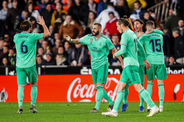 Real Madrid celebrate their late point