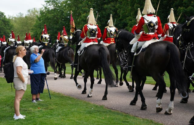 Members of the Household Cavalry set off down the Long Walk towards Windsor Castle prior to the ceremony
