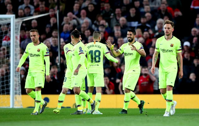 Barcelona's Luis Suarez (second right) celebrates after Luke Shaw had deflected his effort home