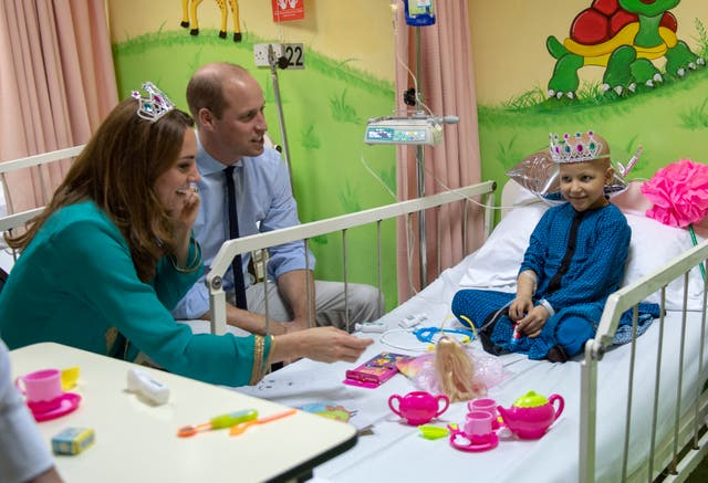The Duke and Duchess of Cambridge with seven-year-old cancer patient Wafia Remain