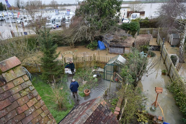 People checking water levels in their back gardens