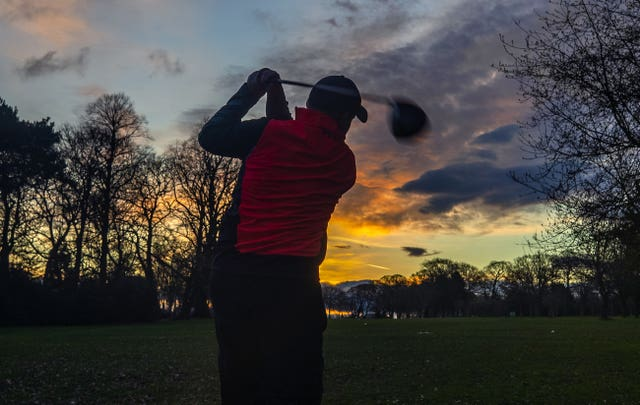 A golfer tees off at Allerton Manor Golf Club in Liverpool