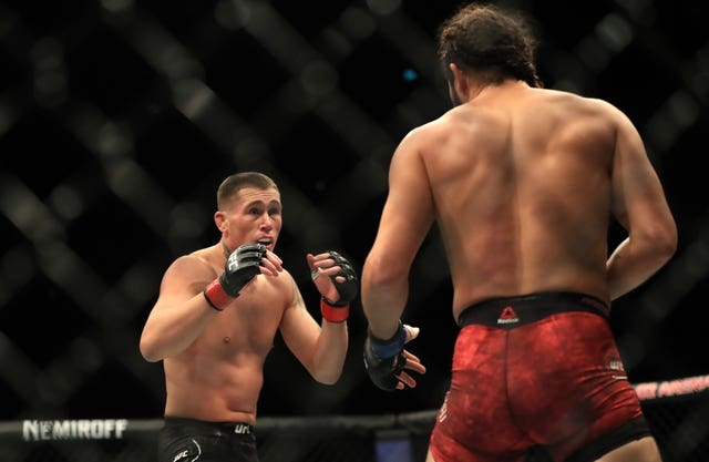 Darren Till (left) had taken the contest to Jorge Masvidal early on. (Simon Cooper/PA Images)