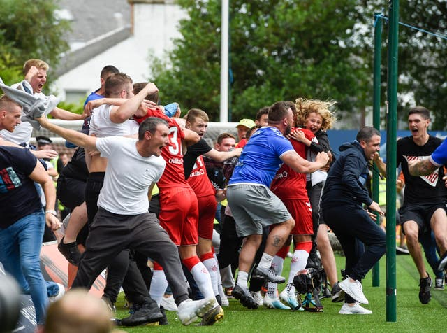 Rangers fans run on to the pitch to celebrate Connor Goldson's stoppage-time winner at Kilmarnock