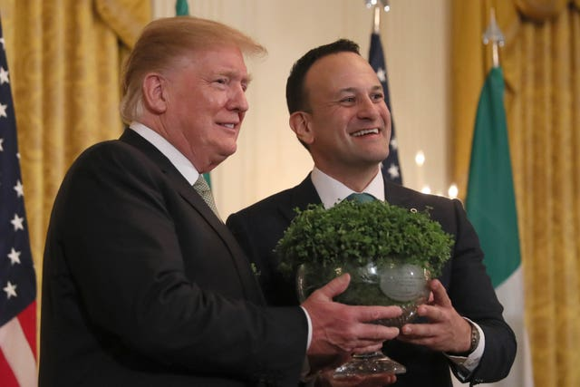 Taoiseach Leo Varadkar presents US President Donald Trump with a bowl of Shamrock during a St Patrick's Day Celebration reception and Shamrock presentation ceremony at the White House with both men awaiting the voters' verdicts (Brian Lawless/PA)