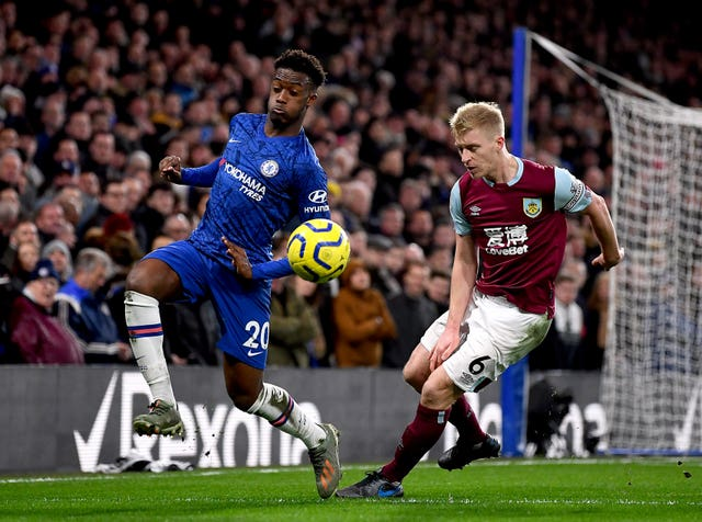 Chelsea's Callum Hudson-Odoi and Burnley's Ben Mee battle for the ball