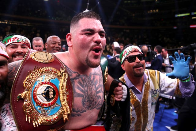 Andy Ruiz Jr celebrates with his title belts after beating Anthony Joshua