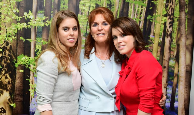 Sarah has been supported in her charitable work by her daughters Beatrice (left) and Eugenie (right). Ian West/PA Wire