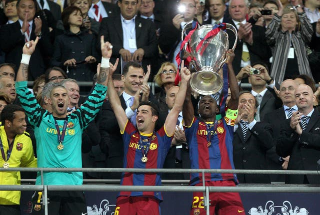 Xavi (centre) captained Barcelona to Champions League success in 2011