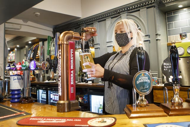 Melanie Scott pulling a pint at the Black Bull pub in Haworth, West Yorkshire