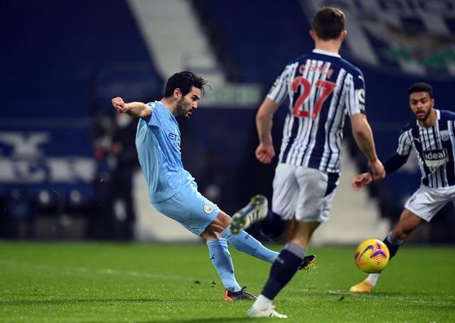 Ilkay Gundogan,left, opens the scoring