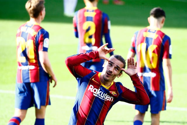Barcelona's Antoine Griezmann celebrates after scoring his side's second goal