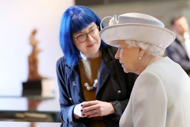 The Queen was described as 'very on the ball' on her visit to the college on its 500th anniversary (Chris Jackson/PA)