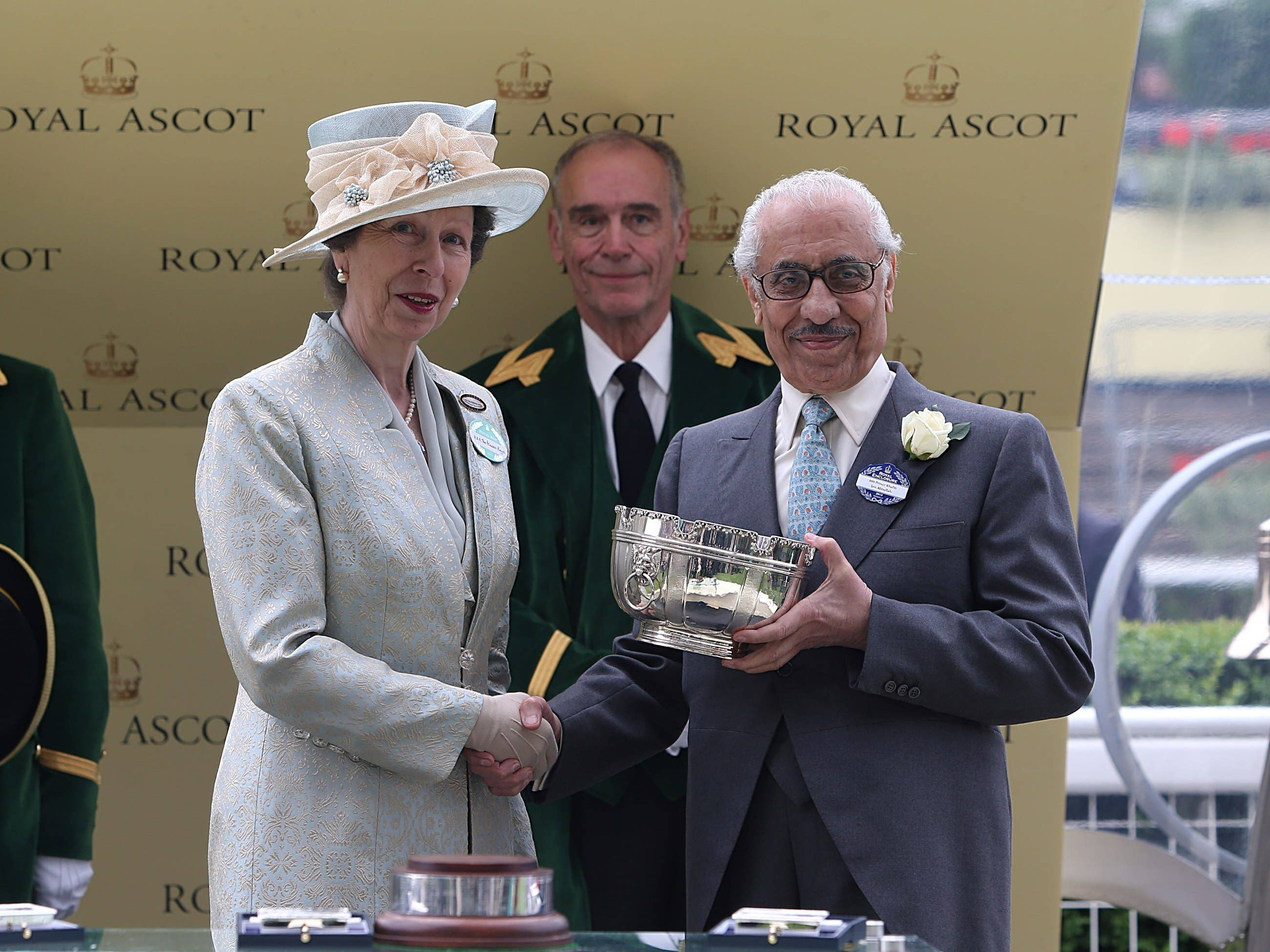 Khalid Abdullah receives his trophy from the Princess Royal after Riposte's 2013 Ribblesdale Stakes victory at Royal Ascot (Steven Paston/PA)