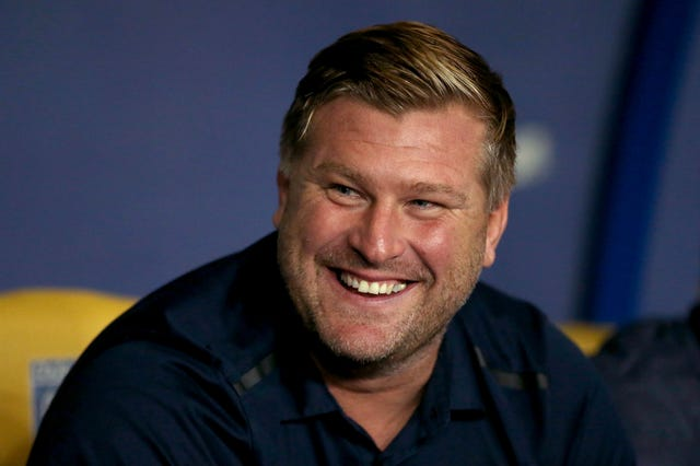 Karl Robinson's Oxford have won each of their last five games (Steven Paston/PA).