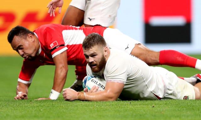 Luke Cowan-Dickie, right. scores against Tonga