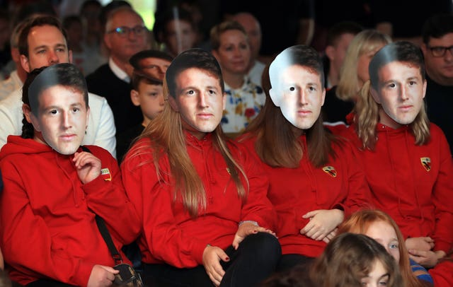 England fans sport Tom Curry face masks at Crewe and Nantwich RFC
