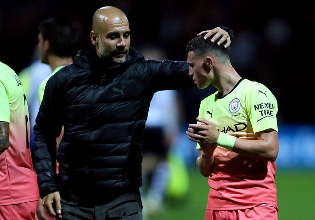 Guardiola (left) demands the best in all competitions