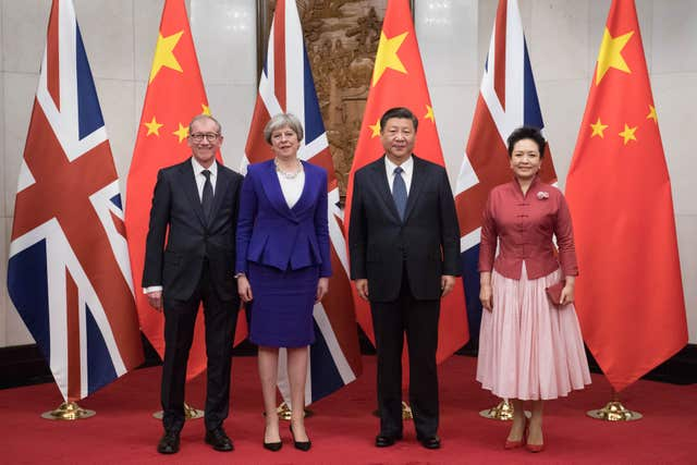 Theresa May and her husband Philip pose for a photograph with Chinese President Xi Jinping and his wife Peng Liyuan at the Diaoyutai State Guest House in Beijing during her visit to China (Stefan Rousseau/PA)