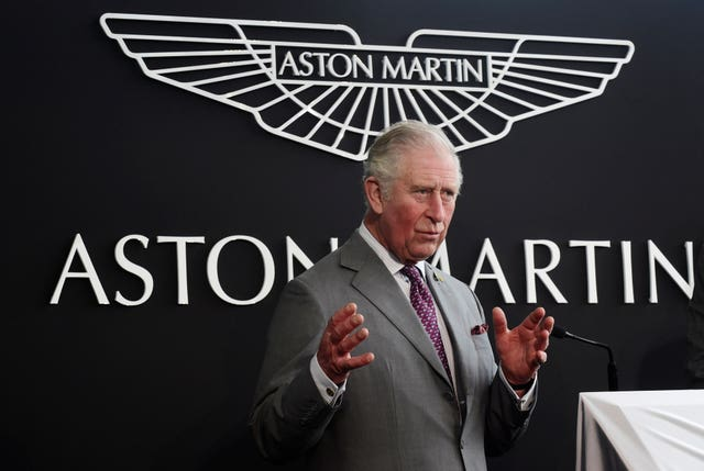 The prince makes a during a visit to the Aston Martin Lagonda factory (Rebecca Naden/PA).