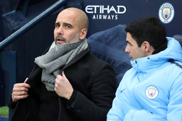 Mikel Arteta, right, and Pep Guardiola at Manchester City