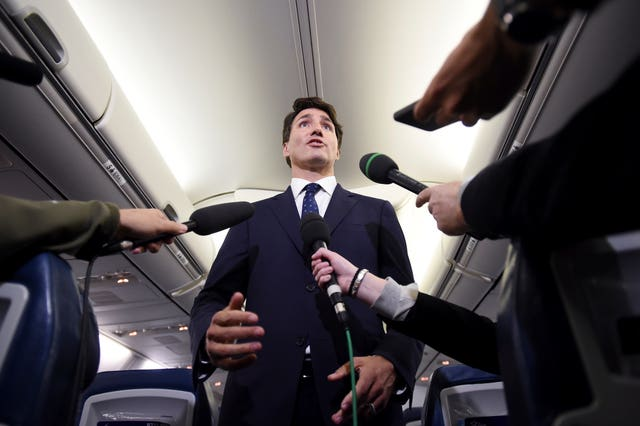 Justin Trudeau addresses reporters on his campaign plane