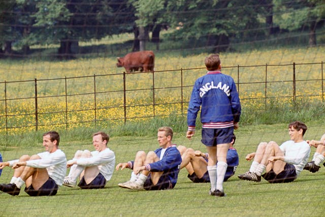 Norman Hunter, far right, trains under the supervision of Les Cocker at England's 1966 World Cup training camp at Lilleshall, Shropshire l