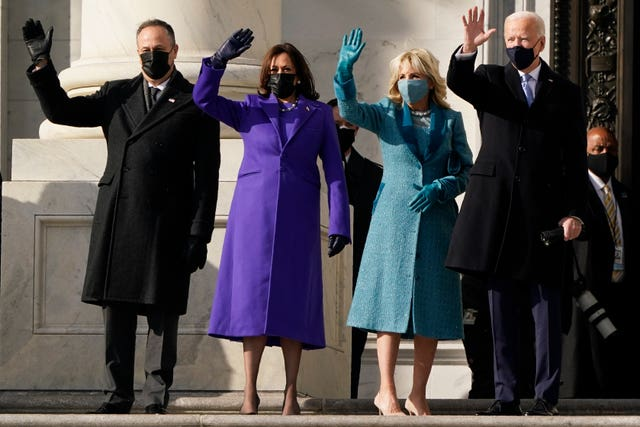President-elect Joe Biden, his wife Jill, vice president-elect Kamala Harris and her husband Doug Emhoff on the steps of the US Capitol for the start of the official inauguration ceremonies, in Washington
