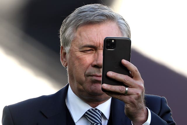 Everton manager Carlo Ancelotti takes a picture of the London Stadium on his mobile phone ahead of his side's game at West Ham. The Italian, formerly manager of Chelsea, returned to the Premier League in December following the sacking of Marco Silva
