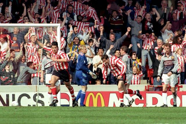Neil Shipperley (left) celebrates scoring Southampton's second goal