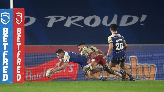 Jack Welsby, left, scores St Helens' winning try