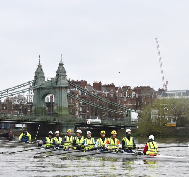 A group of rowers, including former British Olympians and Oxford and Cambridge boat race competitors, taking part in a demonstration in front of Hammersmith Bridge in west London over the Government's inability to agree a repair plan for the bridge after almost two years