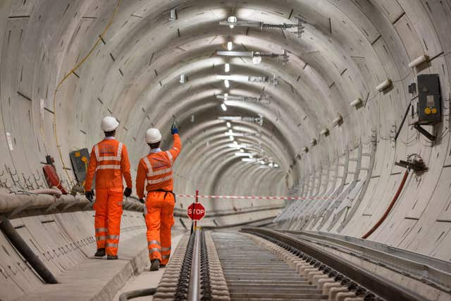 Crossrail engineers walk alongside tracks in Whitechapel, east London. (Image: PA)