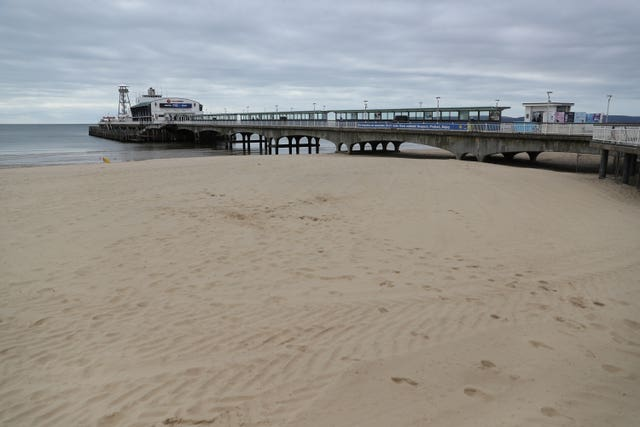 An empty beach and pier at Bournemouth in Dorset