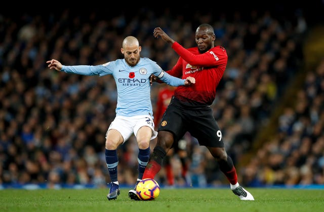 Manchester City's David Silva (left) and Manchester United's Romelu Lukaku (right) battle for the ball
