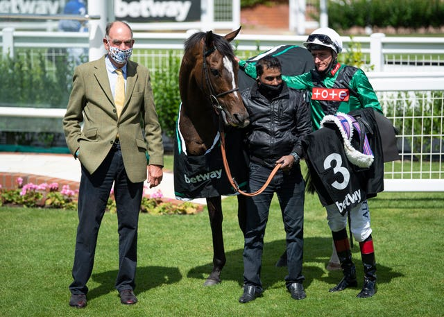 A proud Henry Candy with Limato and Adam Kirby after victory in the Criterion Stakes earlier this year