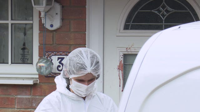 Forensic teams at the house