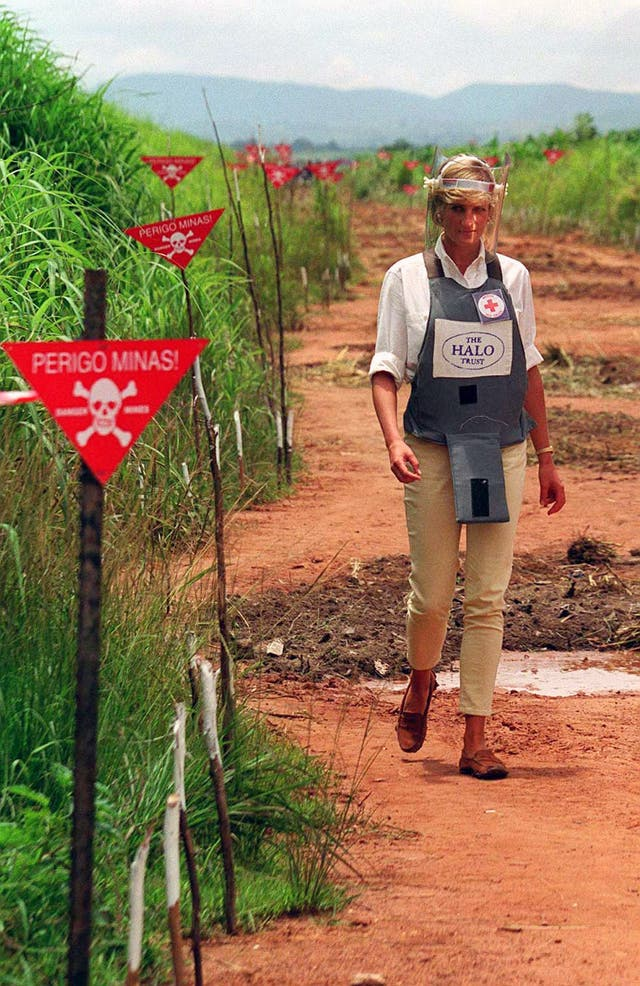 Diana tours a minefield in body armour to see for herself the carnage mines cause, during her visit to Angola
