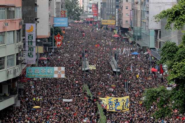 Tens of thousands of protesters march through the streets in Hong Kong