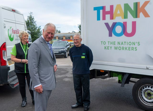 Charles with Asda staff members
