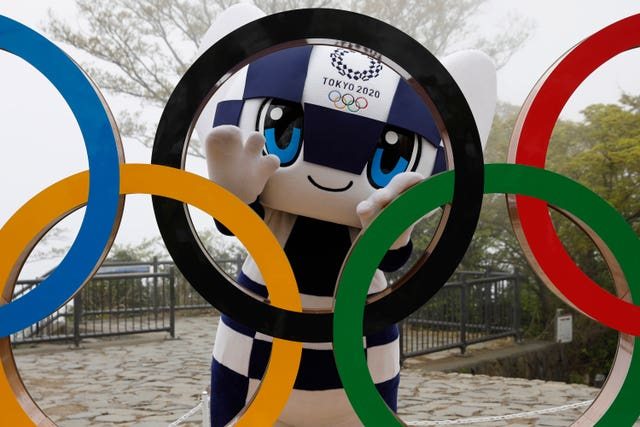 Tokyo 2020 Olympic Games mascot Miraitowa poses with a display of the Olympic Symbol after an unveiling ceremony of the symbol on Mt Takao in Hachioji, west of Tokyo (Kim Kyung-Hoon/AP)