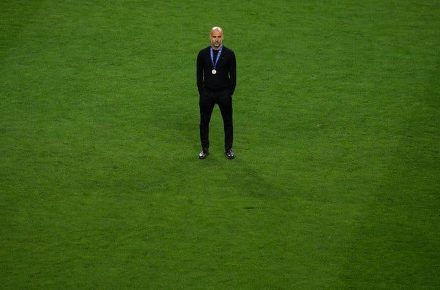 Guardiola cut a dejected figure after City's loss to Chelsea in last season's final
