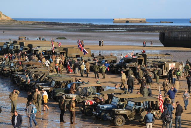 Military vehicles line the beach at Arromanches